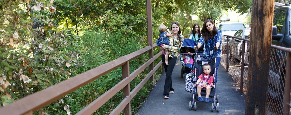 Amata Girls Pushing a Stroller